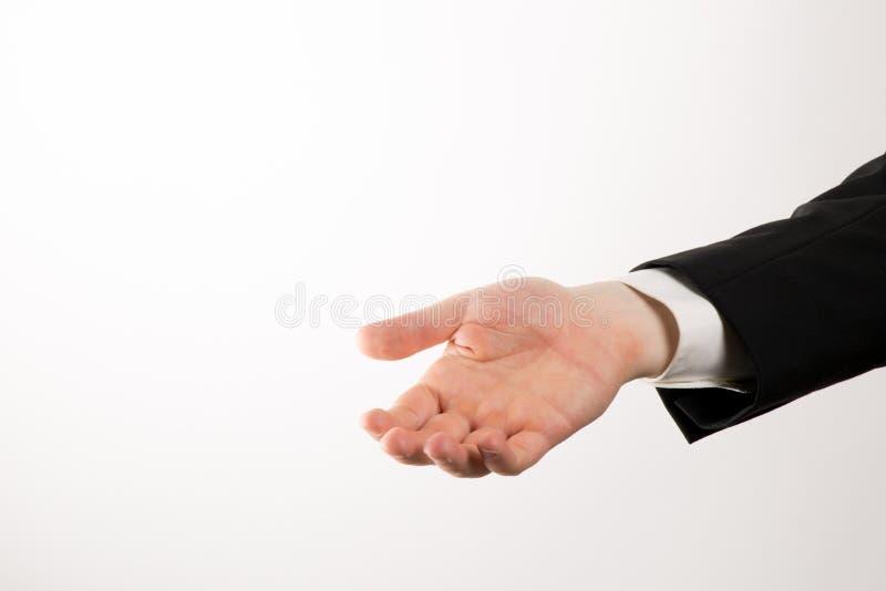 Affärsmannen gömma i handflatan upp och att ge något och att erbjuda hjälp royaltyfri bild