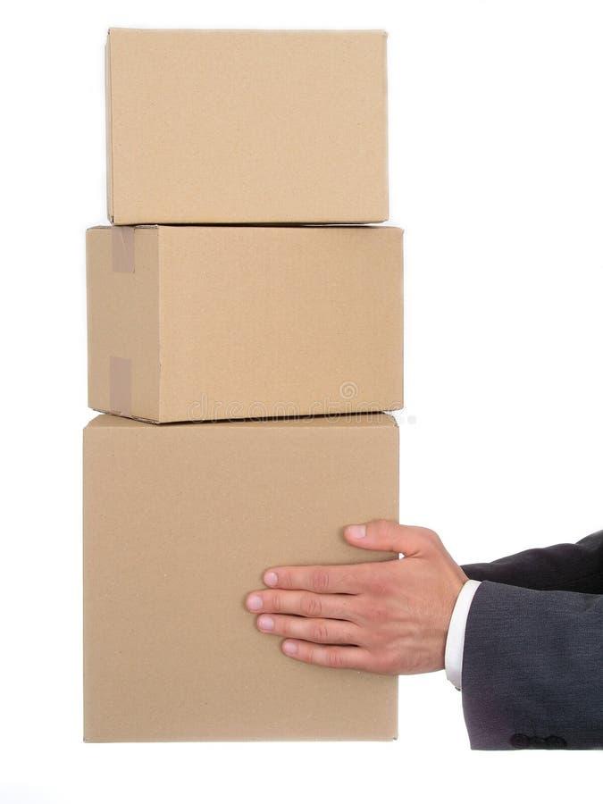 affärsmannen hands holdingpackar s arkivbild