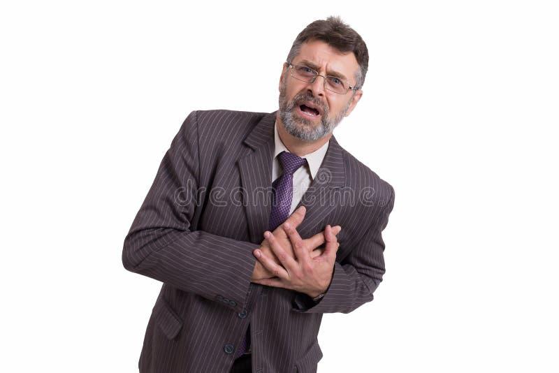 Affärsmannen har en hjärtinfarkt arkivfoto