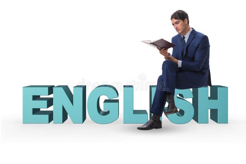 Affärsmannen i begrepp för utbildning för engelskt språk royaltyfri foto