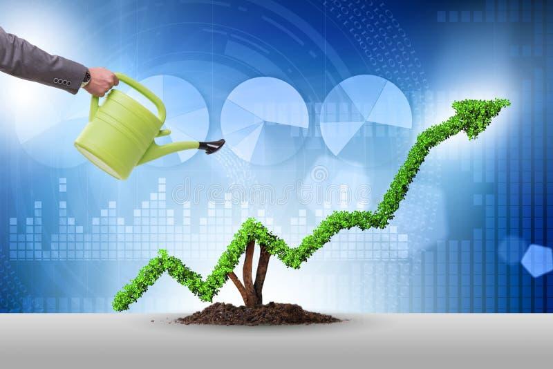 Affärsmannen i investeringbegrepp som bevattnar den finansiella linjen diagram arkivfoton