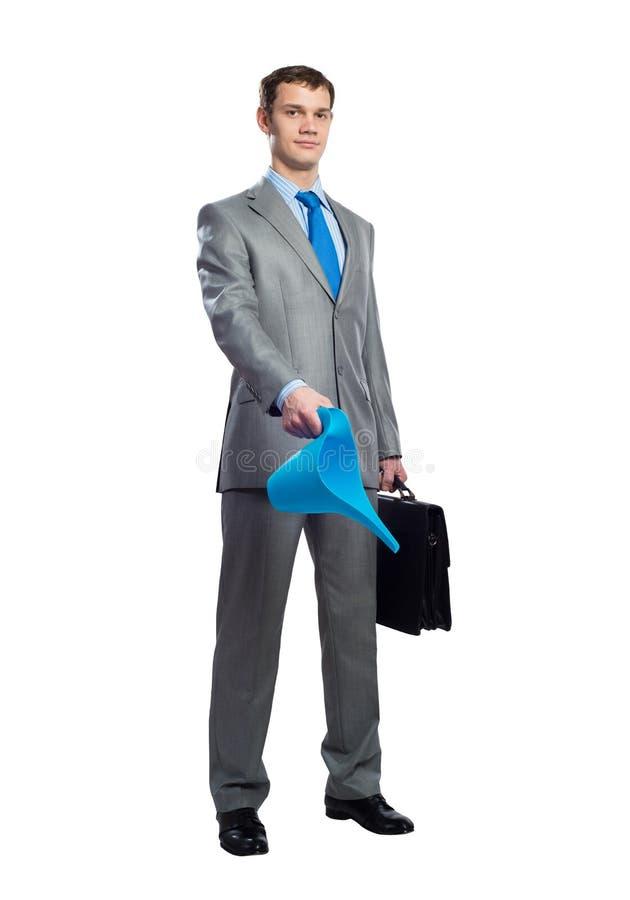 Affärsmannen klädde den gråa affärsdräkten arkivbilder