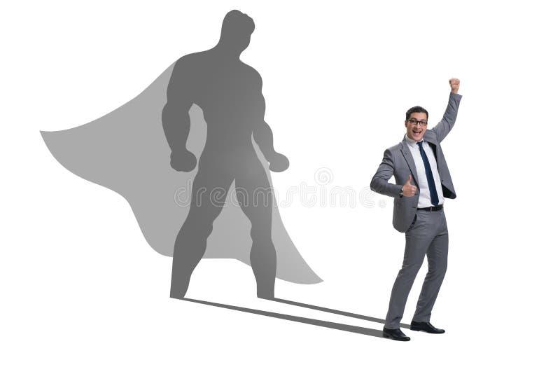 Affärsmannen med ambition av den passande superheroen arkivfoton