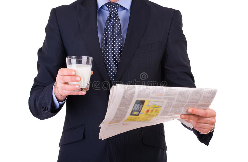 Affärsmannen med exponeringsglas av mjölkar. fotografering för bildbyråer