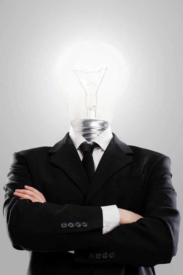 Affärsmannen med lampan head i stället royaltyfria foton