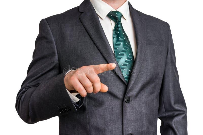 Affärsmannen pekar hans finger på dig royaltyfria foton