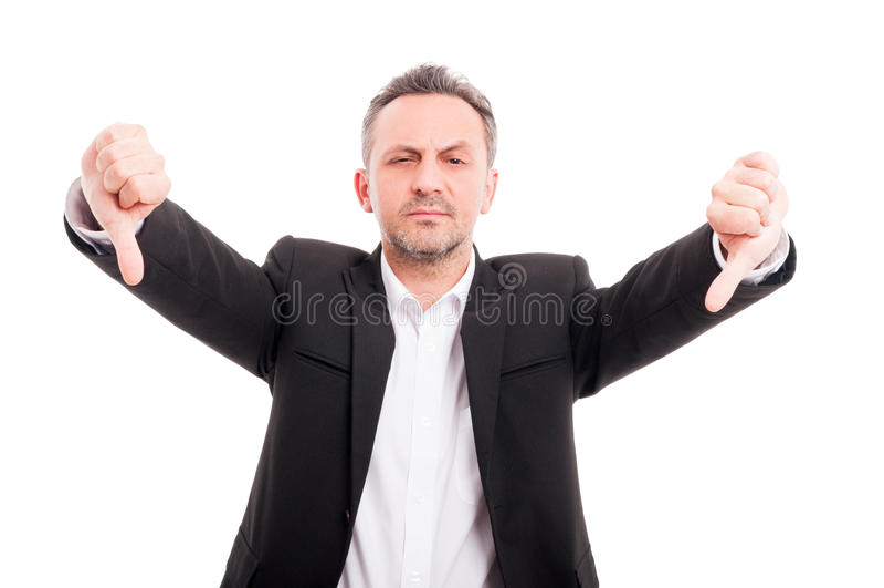 Affärsmannen som gör den dubbla tummen gör en gest ner royaltyfri bild