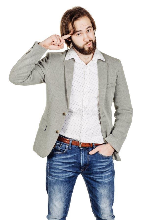Affärsmannen som gör en gest med hans finger mot templet som frågar, är royaltyfria bilder
