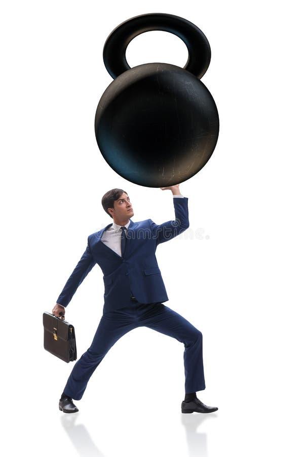Affärsmannen under tung börda på vit bakgrund arkivbild