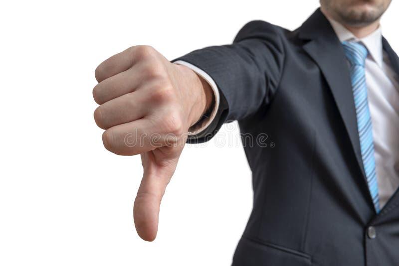 Affärsmannen visar tummar ner gest bakgrund isolerad white royaltyfria foton