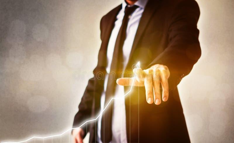 Affärsmanpunkter på aktiemarknaddiagrammet - begrepp för finansaffärsframgång royaltyfri fotografi