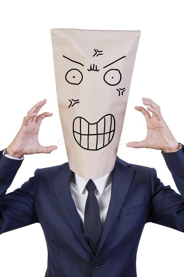 Affärsmanräkning hans huvud med påsen royaltyfri fotografi