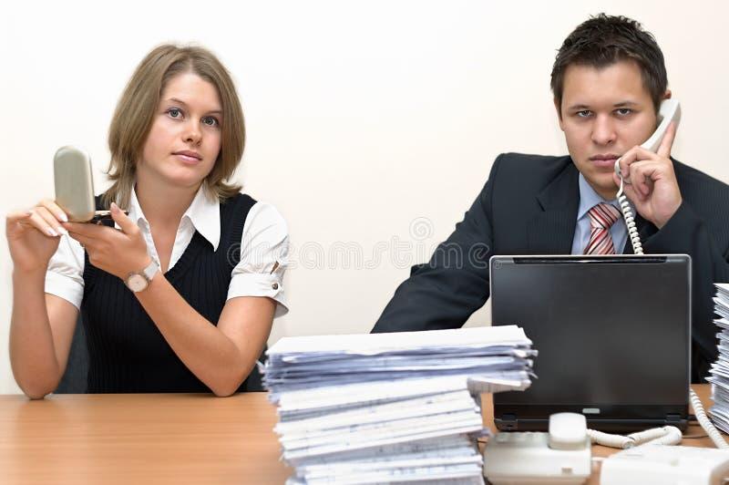 affärsmansekreterareworking royaltyfria foton