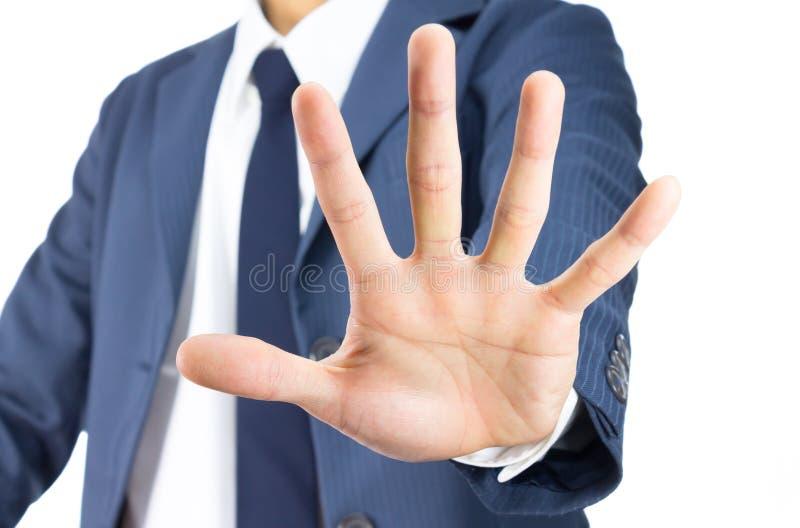 AffärsmanStop Sign Hand gest som isoleras på vit bakgrund arkivfoton