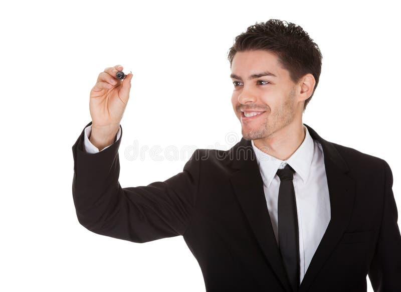 Affärsmanteckning på skärmen arkivfoto