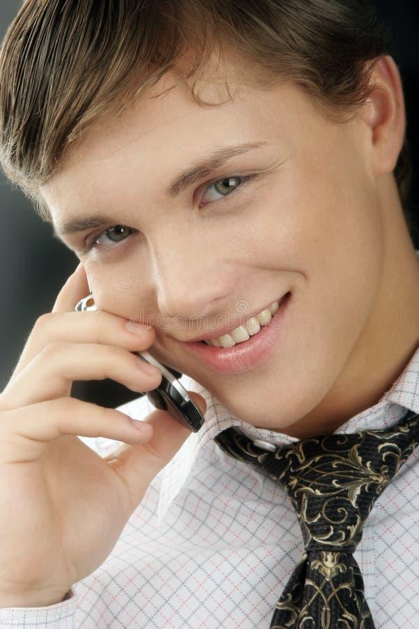 affärsmantelefonbarn royaltyfria bilder