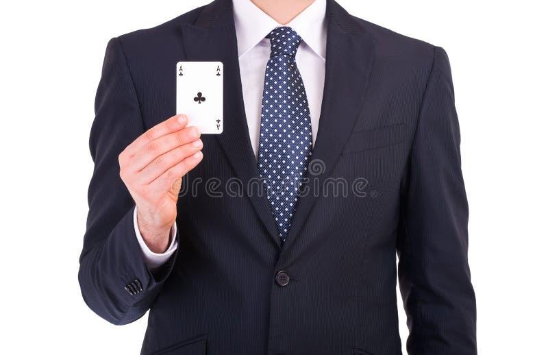 Affärsmanvisning som spelar kortet. arkivbilder