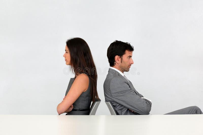 Affärspartners i motsättning royaltyfri bild