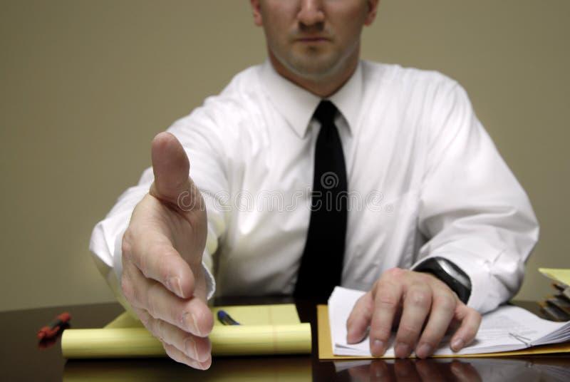 affärsskrivbordman arkivfoto