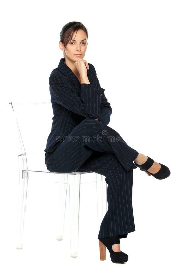 affärsstol som sitter den genomskinliga kvinnan arkivbilder