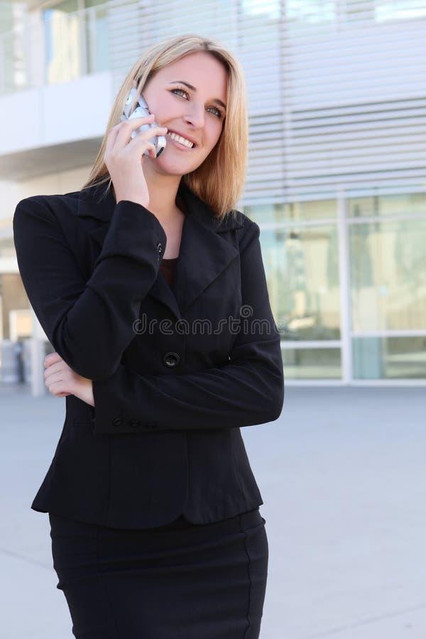 affärstelefonkvinna royaltyfri fotografi