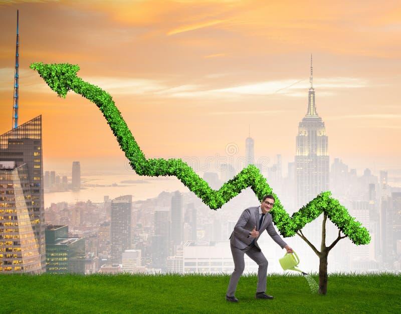 Aff?rsman i investeringbegrepp som bevattnar den finansiella linjen diagram royaltyfri fotografi