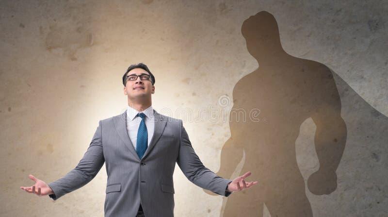 Aff?rsman med ambition av den passande superheroen arkivbilder