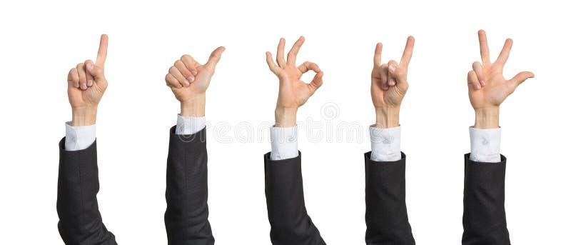 Aff?rsmanhand i dr?kten som visar olika gester royaltyfria foton
