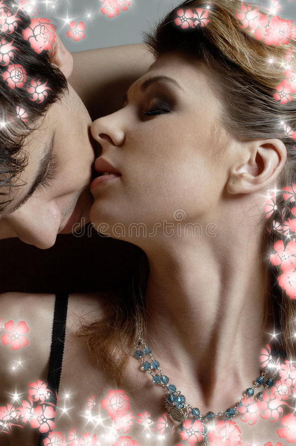 Affair with flowers. Intimate color picture of sweet couple cuddling with flowers stock images