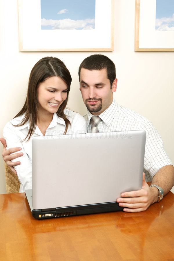 Affair in office. Affair in the office. Young couple sitting together stock image