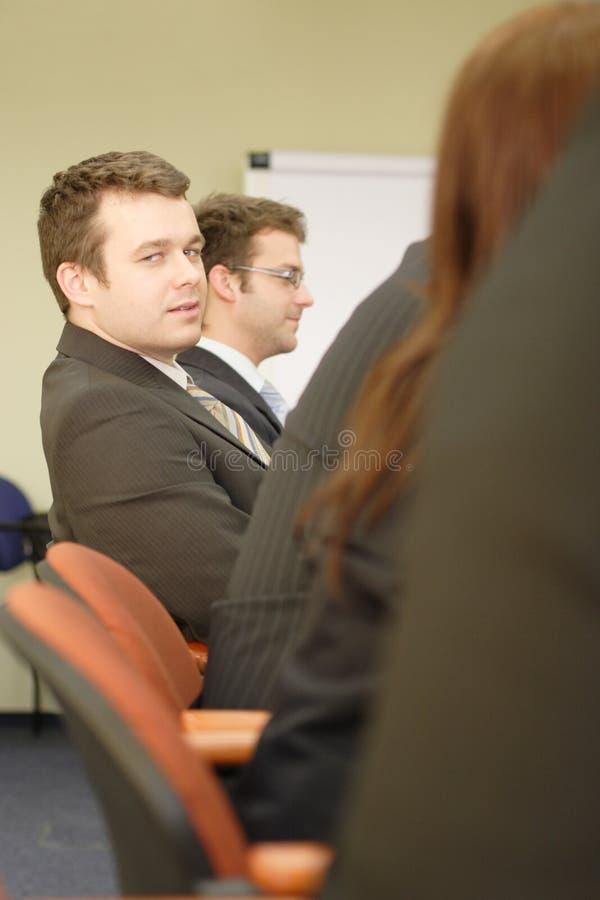 Affaires dans la salle de réunion images stock