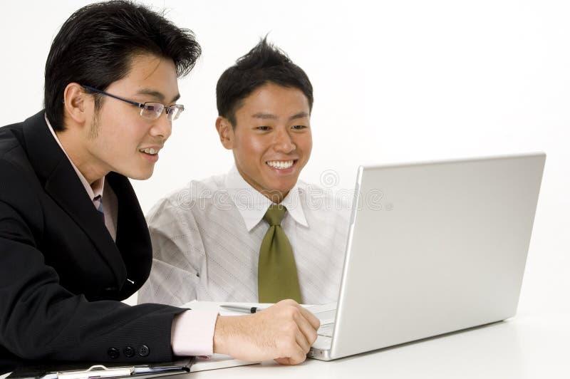Affaires heureuses d'ordinateur portatif images libres de droits