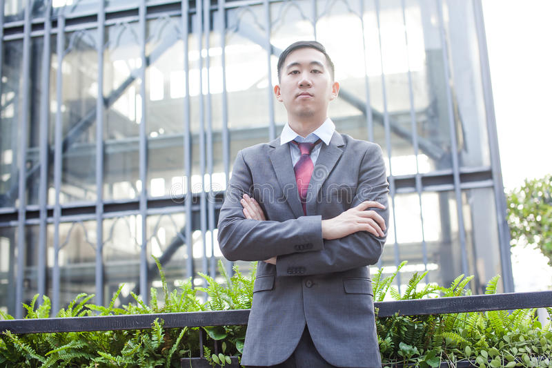 Affare asiatico ambizioso Person Standing fotografie stock