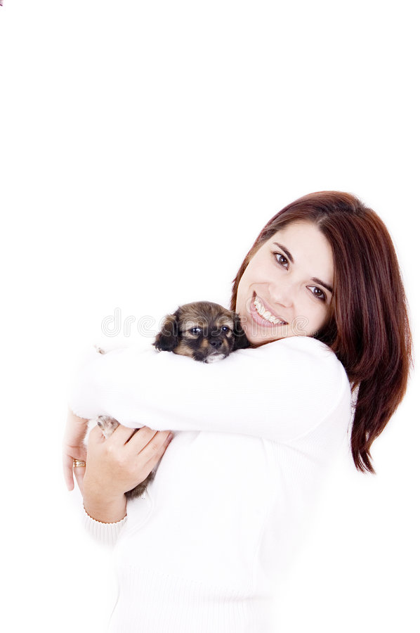 Affection. A woman and little dog show affection to each other stock photo