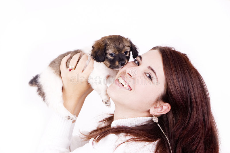 Affection. A woman and little dog show affection to each other royalty free stock photo