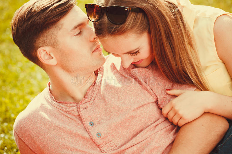 Affectionate couple on grass. royalty free stock photos