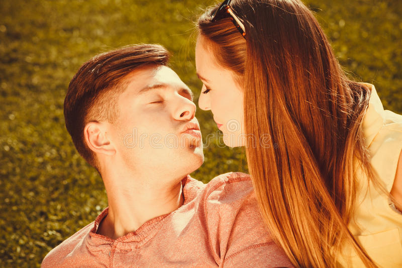 Affectionate couple on grass. stock photography