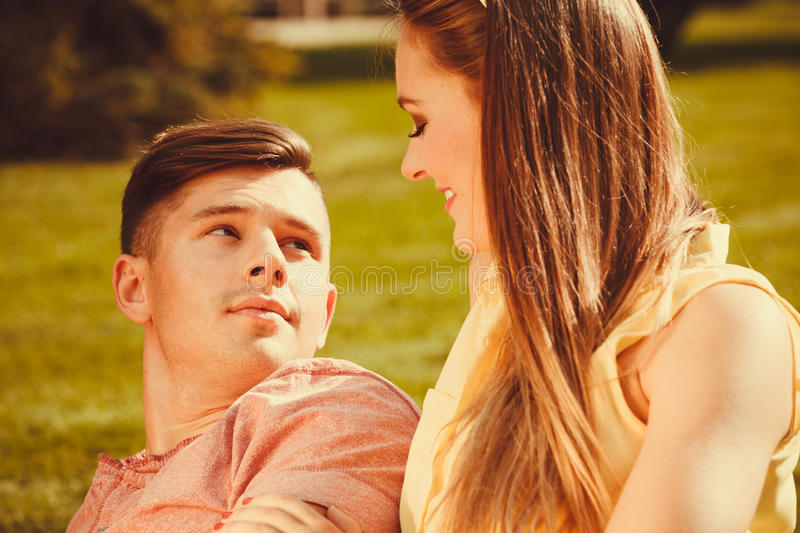 Affectionate couple on grass. royalty free stock image