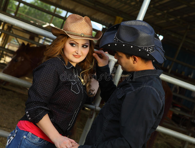 Affectionate Couple At A Horse Stabble Stock Photography