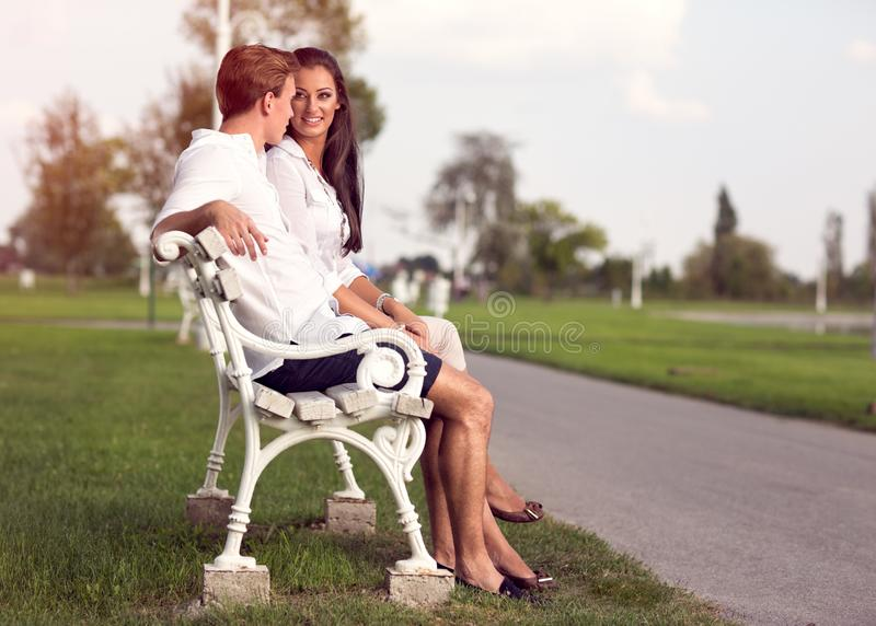 Affectionate couple in park stock images