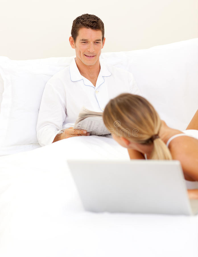 Download Affectionate Couple Relaxing On Their Bed Stock Image - Image: 12642093