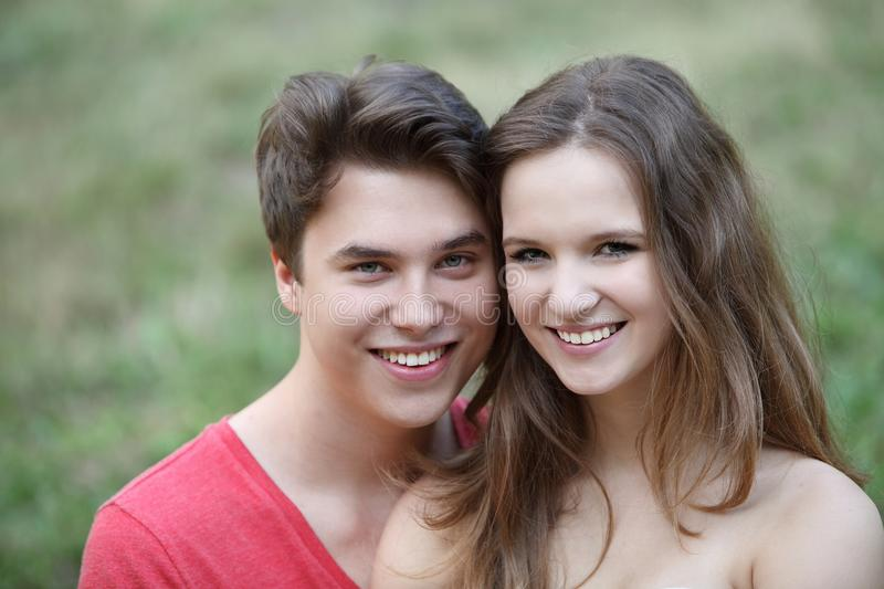Affectionate loving young teenage couple stock photography