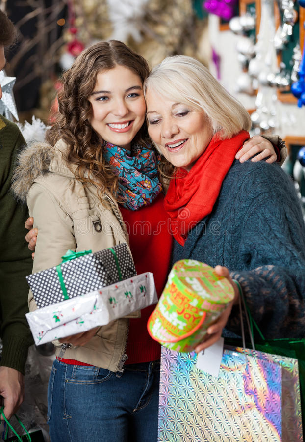 Affectionate Mother And Daughter With Christmas stock photo