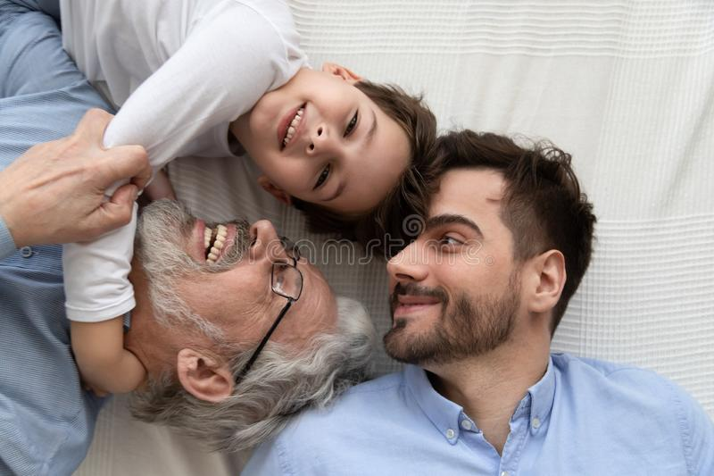 Affectionate multi three generation men family top view closeup portrait. Affectionate multi three 3 generation men family top view close up portrait, cute royalty free stock image