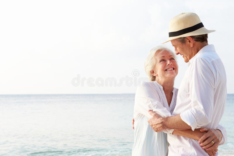Download Affectionate Senior Couple On Tropical Beach Holiday Stock Photo - Image of relaxing, holiday: 32060436