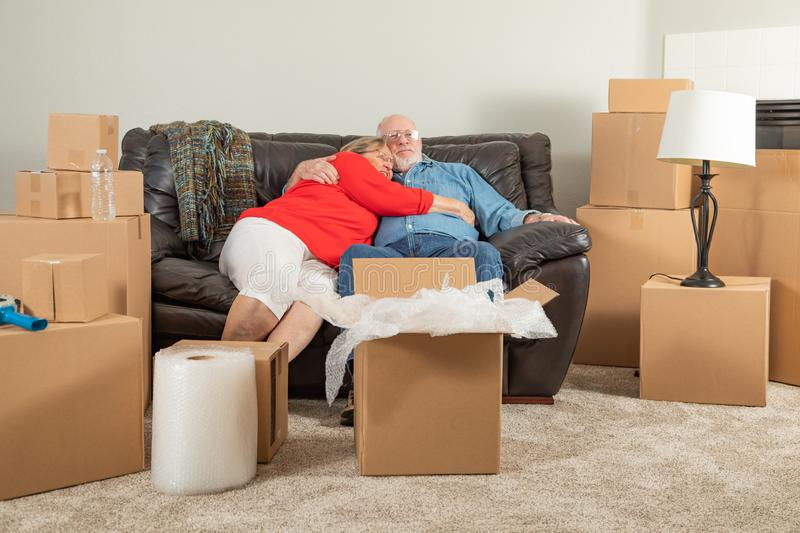 Affectionate Tired Senior Adult Couple Resting on Couch Surround royalty free stock images