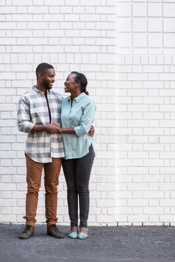 Smiling young African couple standing in the city together royalty free stock photo