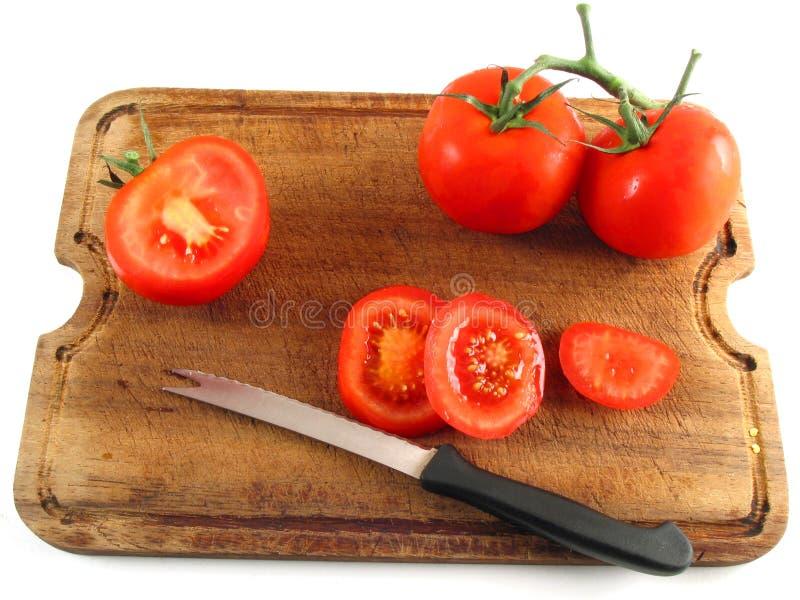 Download Affettare i pomodori immagine stock. Immagine di ristorante - 218793