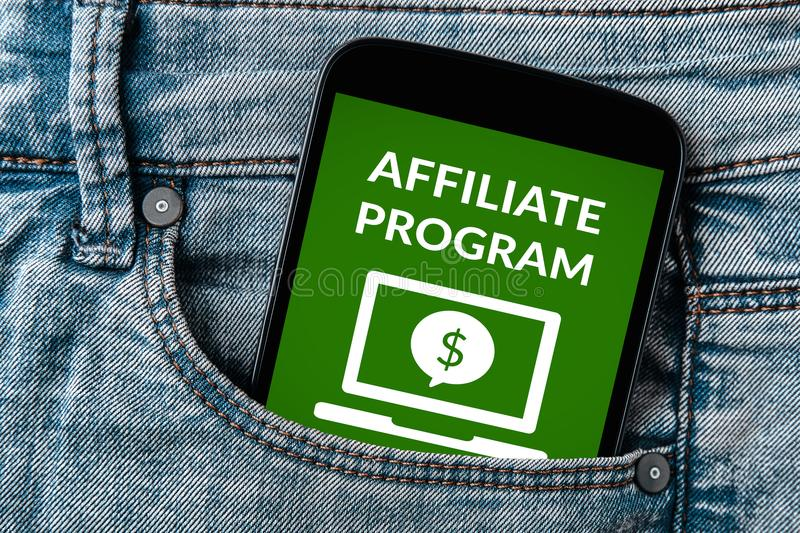 Affiliate program concept on smartphone screen in jeans pocket royalty free stock images