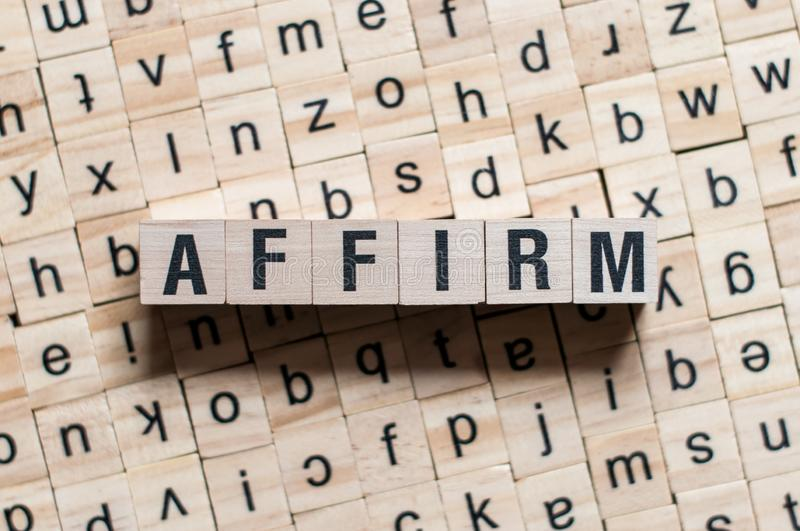 AFFIRM word written on building blocks concept.  stock photography